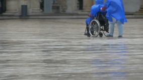 Man in a Wheelchair in Rain stock footage