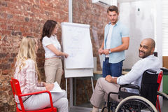 Man in wheelchair smiling at camera during presentation Stock Photography