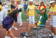 Man in wheelchair at Special Olympics. Man in wheelchair at finish line, Special Olympics at UCLA, Los Angeles, California Stock Photos