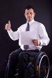 Man in wheelchair is successful Royalty Free Stock Images