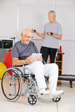 Man in wheelchair with tablet computer Stock Photo