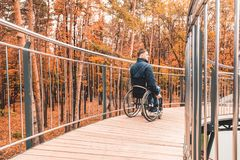 Man in a wheelchair use a wheelchair ramp. stock image