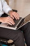 Man on Wheelchair Using Laptop Royalty Free Stock Photo