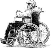 Man in wheelchair Stock Image
