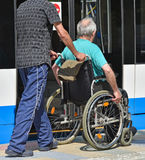 Man in wheelchair waits for the tram Stock Photos