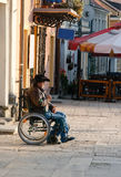 A man in a wheelchair on a walk Royalty Free Stock Image