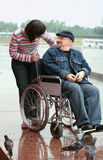 Man in wheelchair and woman Royalty Free Stock Photography