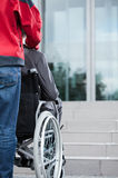 Man on wheelchair before work Royalty Free Stock Photo