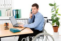 Man in wheelchair is working Stock Photo