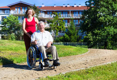 Man on wheelchair with young woman Royalty Free Stock Photos