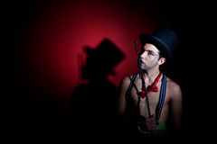 Man with whip in top hat. Man in top hat with shadow on the wall stock images