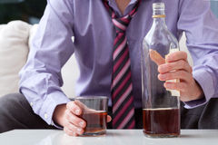 Man with whiskey Stock Photo