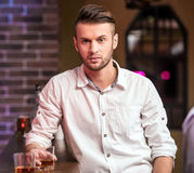 Man with whisky Stock Images