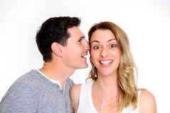 Man whisper in the ear of his girlfriend Royalty Free Stock Photography