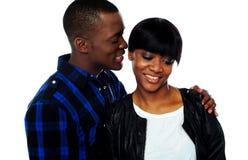 Man whispering in girlfriends ear Stock Photos