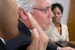 Man whispering in interview Stock Image