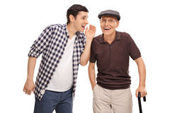 Man whispering to his grandpa Stock Photo
