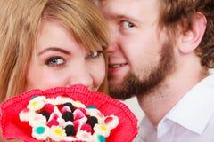 Man whispering to woman ear sharing secret. Stock Photo