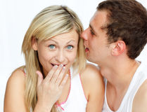 Man whispering a woman a secret Stock Photography