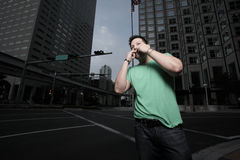 Man whistling for a cab stock image