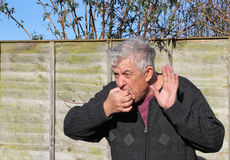 Man whistling and waving. Royalty Free Stock Photography