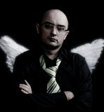 Man with white angel wings looking forward Royalty Free Stock Photography