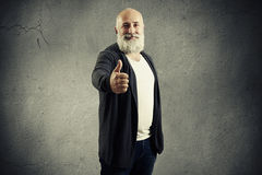 Man with white beard showing thumbs up Royalty Free Stock Photography