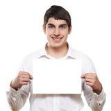 Man white blank. Man holding smiling white blank  advertising royalty free stock photo