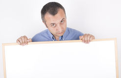 Man with white board. studio shot. Stock Image