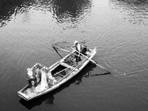Man in White Boat Royalty Free Stock Images
