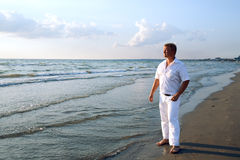 Man in white clothing at sea Royalty Free Stock Photo