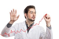 A man in a white coat drawing a positive chart on a clear transparent glass. White background Royalty Free Stock Photos