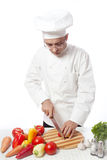 Man in white cooking Royalty Free Stock Photos