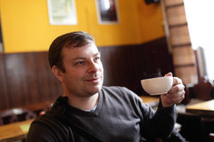 Man with white cup of tea Stock Photography