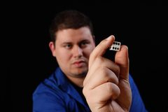 Man with white dice right. A man with a six sided dice ready to toss Royalty Free Stock Photos