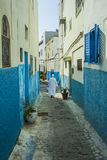 Man in white djellaba walking in medina of Rabat Stock Photo
