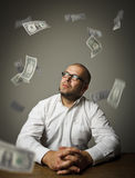 Man in white and dollars Royalty Free Stock Images