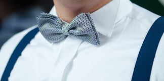 Man in White Dress Shirt Blue Suspenders and Gray Polka Dotted Bowtie Stock Images
