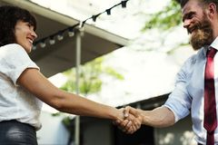 Man In White Dress Shirt And Maroon Neck Tie Shaking Hands With Girl In White Dress Stock Images