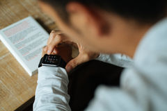 Man in White Dress Shirt Using Black Smart Watch Royalty Free Stock Photos