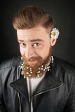 Man with white flowers inside his beard Royalty Free Stock Photography