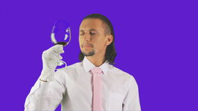 A man in white gloves drinks the wine stock video