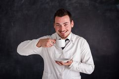 Man in a white gown Stock Photography