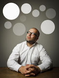 Man in white and gray bubbles. Royalty Free Stock Images