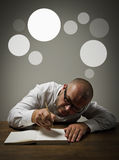 Man in white and gray bubbles. Royalty Free Stock Image