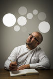 Man in white and gray bubbles. Stock Image