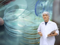 A man in white great coat uniform and Plastic Petri trial or Pet Stock Photo