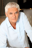 Man with white hair Stock Photography