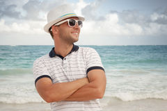 Man in white hat and sunglasses on the sea coast Stock Images