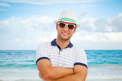 Man in white hat and sunglasses on the sea coast Royalty Free Stock Image